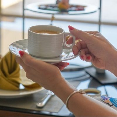 woman-holding-a-cup-of-coffee-